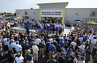 NWA Democrat-Gazette/ANDY SHUPE<br /> Students, faculty and community members applaud Tuesday, Sept. 22, 2015, as Martin Schoppmeyer Jr., superintendent and founder of Haas Hall Academy, speaks during a dedication ceremony for the school's Starr Scholar Center in Fayetteville. The newly renovated facility is located at 380 N. Front Street and is named in honor of Billie Jo Starr and her family.