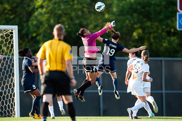 Western New York Flash goalkeeper Adrianna Franch (24) and Sky Blue FC forward Kelley O'Hara (19) go for a ball. The Western New York Flash defeated Sky Blue FC 3-0 during a National Women's Soccer League (NWSL) match at Yurcak Field in Piscataway, NJ, on June 8, 2013.
