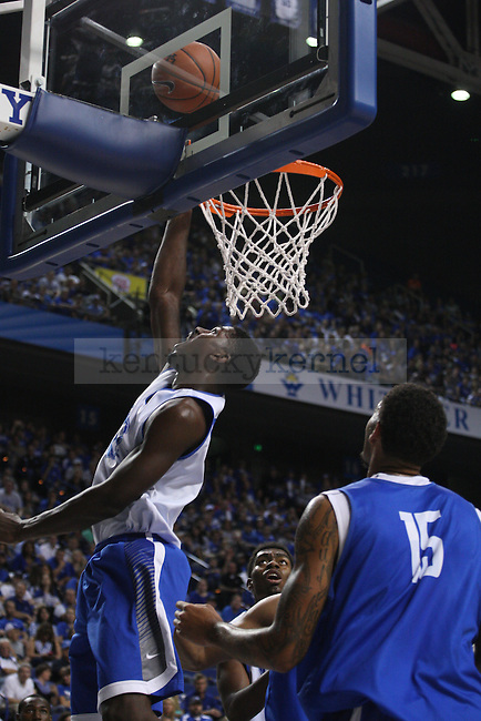 Forward Alex Poythress shoots a layup during the first half of the Blue-White Scrimmage at Rupp Arena on Monday, October 27, 2014 in Lexington, Ky. Photo by Adam Pennavaria | Staff
