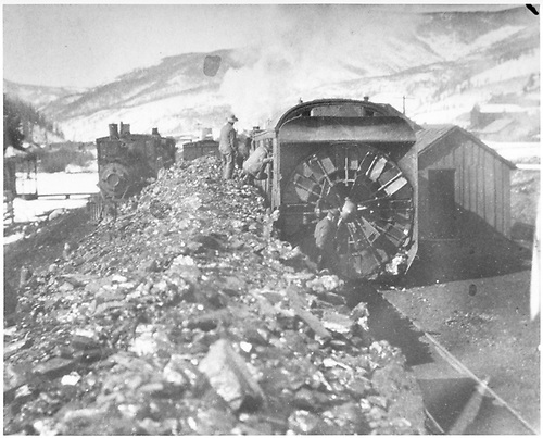 C&amp;S rotary snowplow crew entering the cab from atop loaded coal gondolas on an adjoining track.<br /> C&amp;S