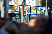 """Friends of animals with Matteo Salvini.<br /> <br /> Rome, 19/10/2019. Today, tens thousands of people (200,000 for the organisers, 50,000 for the police) gathered in Piazza San Giovanni to attend the national demonstration """"Orgoglio Italiano"""" (Italian Pride) of the far-right party Lega (League) of Matteo Salvini. The demonstration was supported by Silvio Berlusconi's party Forza Italia and Giorgia Meloni's party Fratelli d'Italia (Brothers of Italy, right-wing).  <br /> The aim of the rally was to protest against the Italian coalition Government (AKA Governo Conte II, Conte's Second Government, Governo Giallo-Rosso, 1.) lead by Professor Giuseppe Conte. The 66th Government of Italy is a coalition between Five Star Movement (M5S, 2.), Democratic Party (PD – Center Left, 3.), and Liberi e Uguali (LeU – Left, 4.), these last two parties replaced Lega / League as new members of a coalition based on Parliamentarian majority as stated in the Italian Constitution. The Governo Conte I (Conte's First Government, 5.) was 14-month-old when, between 8 and 9 of August 2019, collapsed after the Interior Minister Matteo Salvini withdrew his euroskeptic, anti-migrant, right-wing Lega / League (6.) from the populist coalition in a pindaric attempt (miserably failed) to trigger a snap election.<br /> <br /> Footnotes & Links:<br /> 1. http://bit.do/feK6N<br /> 2. http://bit.do/e7JLx<br /> 3. http://bit.do/e7JKy<br /> 4. http://bit.do/e7JMP<br /> 5. http://bit.do/e7JH7<br /> 6. http://bit.do/eE7Ey<br /> https://www.leganord.org<br /> http://bit.do/feK9X (Source, TheGuardian.com)<br /> Reportage: """"La Fabbrica Della Paura"""" (The Factory of Fear): http://bit.do/feLcy (Source Report, Rai.it - ITA)<br /> (Update) Reportage: """"La Fabbrica Social Della Paura"""" (The Social Network Factory of Fear): http://bit.do/fe8Pn (Source Report, Rai.it - ITA)"""