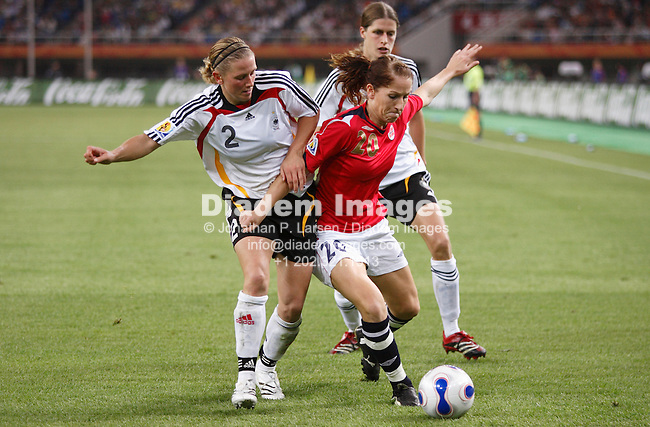 TIANJIN, CHINA - SEPTEMBER 26:  Kerstin Stegemann of Germany (2) defends against Lise Klaveness of Norway (20) during a FIFA Women's World Cup semi-final match September 26, 2007 in Tianjin, China.  (Photograph by Jonathan P. Larsen)