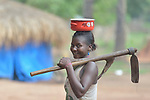 A woman with tools in a camp for more than 5,000 displaced people in Riimenze, in South Sudan's Gbudwe State, what was formerly Western Equatoria. Families here were displaced at the beginning of 2017, as fighting between government soldiers and rebels escalated.<br /> <br /> Two Catholic groups, Caritas Austria and Solidarity with South Sudan, have played key roles in assuring that the displaced families here have food, shelter and water.<br /> The camp formed around the Catholic Church in Riimenze as people fled violence in nearby villages for what they perceived as the safety offered by the church.