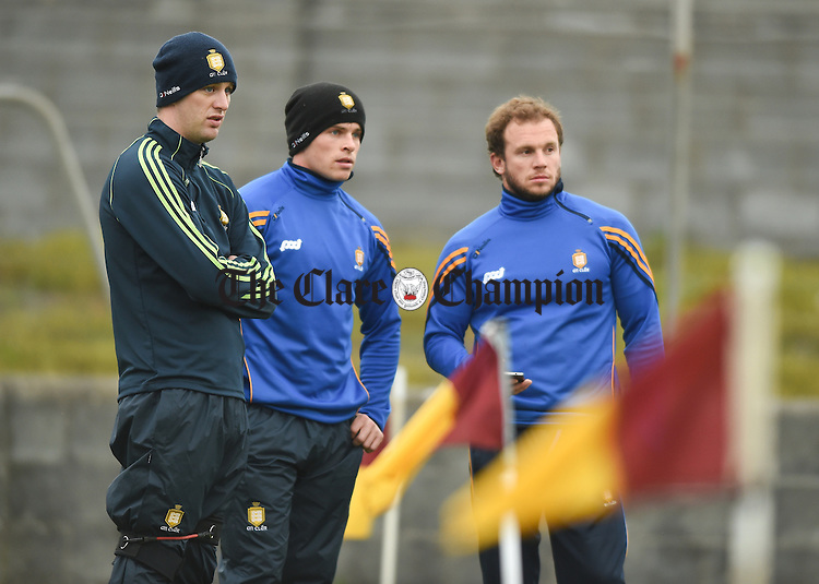 Enda Coughlan, Sean Collins and Chris de Looze  of Clare look on during their game against Dublin as part of the official switching on of the new floodlighting at Hennessy park, Miltown Malbay. Photograph by John Kelly.