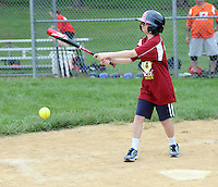 Ryan Shenberger puts the ball into play during the Miracle League Festival, a softball tournament for players with intellectual and physical challenges at George School Saturday June 20, 2015 in Newtown, Pennsylvania. (Photo by William Thomas Cain)
