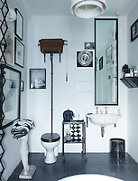 A rusting old-fashioned cistern is a feature of the black and white bathroom