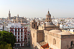 Cityscape view over rooftops towards the cathedral, Seville, Spain the Iglesia de la Anunciación in foreground