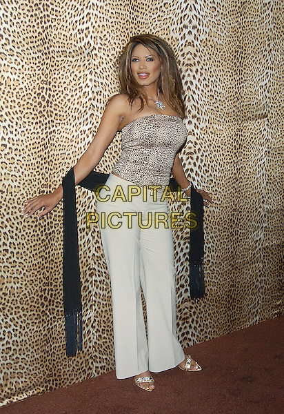 TRACI BINGHAM .Roberto Cavalli unveils his Beverly Hills Boutique on Rodeo Drive with a private party to benefit Race to Erase MS at the Roberto Cavalli Boutique. Beverly Hills, California .February 15th, 2005.full length leopard print animal print strapless top white trousers brown scarf sash.www.capitalpictures.com.sales@capitalpictures.com.© Capital Pictures.