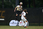 10 September 2016: Wake Forest's Hunter Bandy (20) heads the ball over Virginia's Daniel Barir (DAN) (15). The Wake Forest University Demon Deacons hosted the University of Virginia Cavaliers in a 2016 NCAA Division I Men's Soccer match. Wake Forest won the game 1-0 in sudden death overtime.
