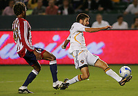 CD Chivas USA defender Lawson Vaughn (25) chases down LA Galaxy midfielder Kyle Martino (18) late in the second half. CD Chivas USA defeated the LA Galaxy in the Super Clasico 3-0 at the Home Depot Center in Carson, CA, Thursday, September 13, 2007.