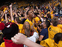 Richard Solomon of California celebrates with the fans after winning the game against Arizona at Haas Pavilion in Berkeley, California on February 1st, 2014.  California Golden Bears defeated Arizona Wildcats, 60-58.