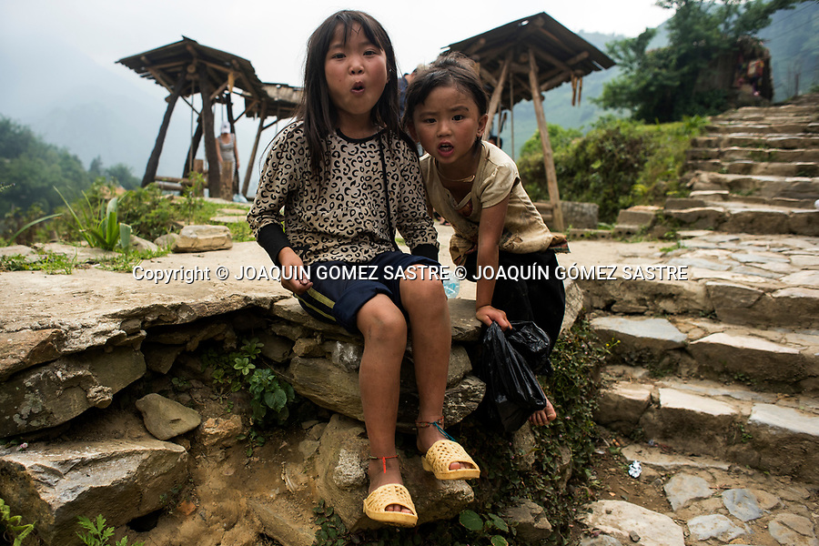 Two girls in The Cat Cat village is characterized by its naturally splendid tranquil landscape, and the customs and cultural activities of ethnic peoples. In 2004, the tourism company of Lao Cai Province invested in building infrastructure and rebuilding the road to the village. This made Cat Cat a tourist site, with the aim of preserving and taking advantage of the traditional trades of the ethnic Hmong people in the northern part of Vietnam<br /> CAT CAT- VIETNAM