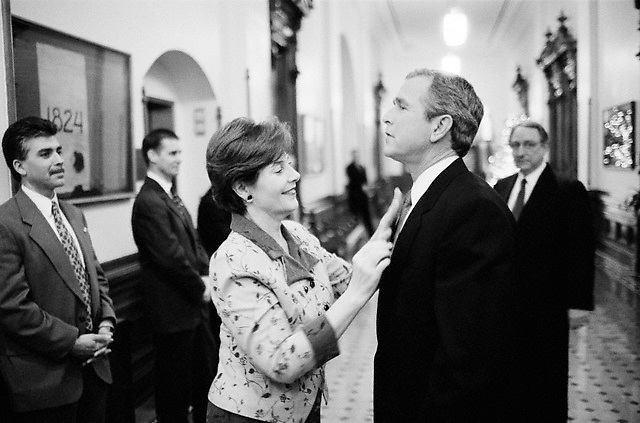 13 Dec 2000, Austin, Texas, USA --- Laura Bush straightens President-Elect George W. Bush's tie before his first speech after the Supreme Court ruling that ended the 2000 presidential election in his favor. Bush was granted the presidency after the controversial vote recount in Florida. --- Image by © Brooks Kraft/Sygma/Corbis