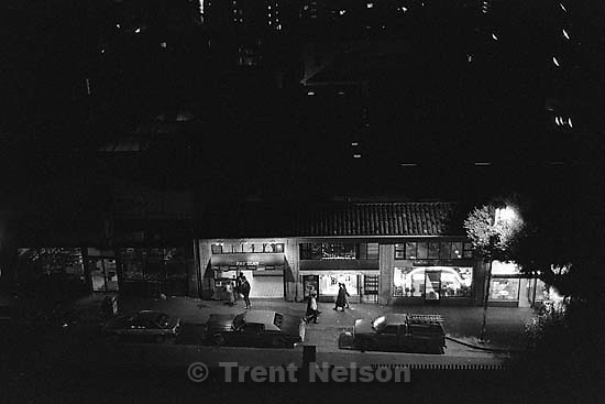 Looking down at Fat Slice and other stores on Telegraph Avenue at night.<br />