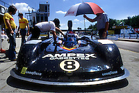 The pit crew for Bobby Rahal's Prophet 1/Chevrolet works on the car during practice for the Can-Am race on July 6, 1980, at the Watkins Glen Grand Prix Race Course near Watkins Glen, New York.