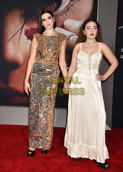 WESTWOOD, CA - FEBRUARY 05: Dua Lipa (L) and guest attend the Premiere Of 20th Century Fox's 'Alita: Battle Angel' at Westwood Regency Theater on February 05, 2019 in Los Angeles, California.<br /> CAP/ROT/TM<br /> ©TM/ROT/Capital Pictures