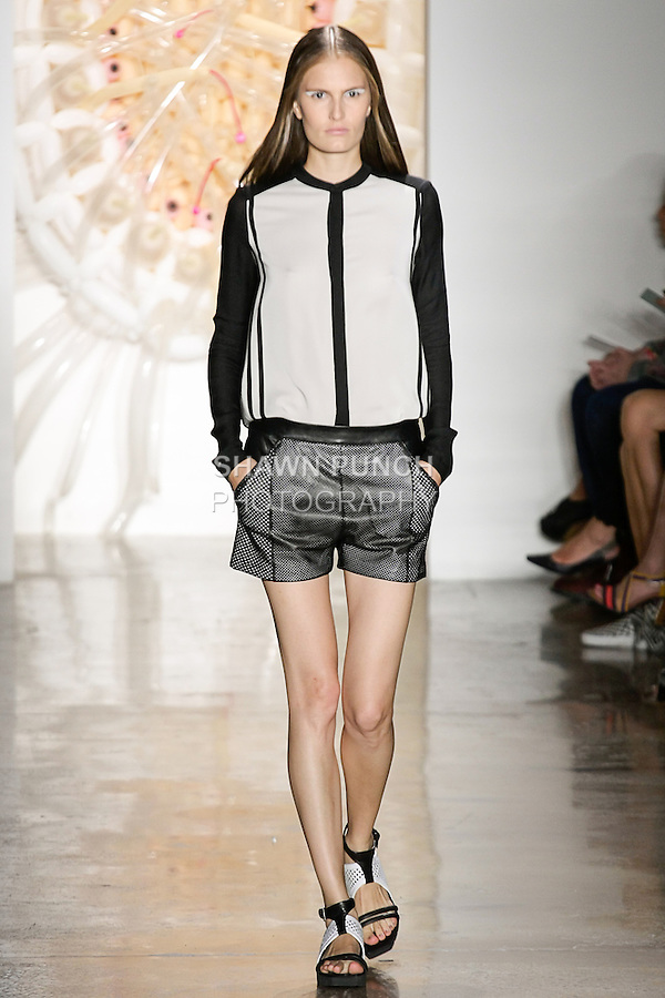 Alla walks runway in an outfit from the Ohne Titel Spring Summer 2013 collection by Alexa Adams and Flora Gill, during Milk Made Fashion Week Spring 2013 in New York City.