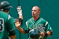 April 23, 2011:    Stetson Hatters lf Jeff Simpson (3) is congratulated by team mates after scoring a run in the first inning during Atlantic Sun Conference action between Stetson Hatters and Jacksonville University Dolphins at John Sessions Stadium in Jacksonville, Florida.  Jacksonville defeated Stetson 10-4...........
