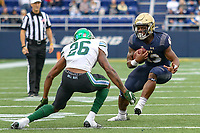 Annapolis, MD - October 26, 2019: Navy Midshipmen wide receiver Chance Warren (13) avoids Tulane Green Wave cornerback Thakarius Keyes (26) tackle during the game between Tulane and Navy at  Navy-Marine Corps Memorial Stadium in Annapolis, MD.   (Photo by Elliott Brown/Media Images International)
