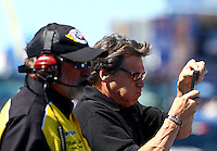 Sept. 21, 2013; Ennis, TX, USA: Texas governor Rick Perry (right) reacts as a car launches off the starting line alongside NHRA starter Mark Lyle during qualifying for the Fall Nationals at the Texas Motorplex. Mandatory Credit: Mark J. Rebilas-