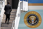 President Barack Obama runs up the steps of Air Force One at the Reno-Tahoe International Airport, in Reno, Nev. on Friday, May 11, 2012. (AP Photo/Cathleen Allison)