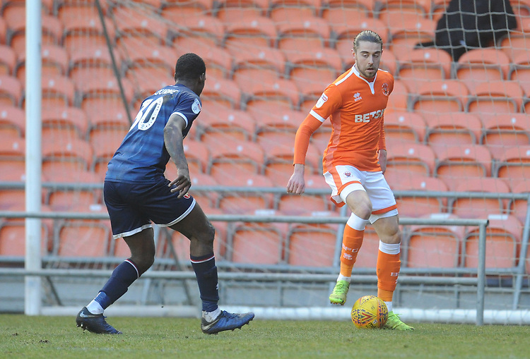Blackpool's Antony Evans under pressure from Walsall's Isaiah Osbourne<br /> <br /> Photographer Kevin Barnes/CameraSport<br /> <br /> The EFL Sky Bet League One - Blackpool v Walsall - Saturday 9th February 2019 - Bloomfield Road - Blackpool<br /> <br /> World Copyright &copy; 2019 CameraSport. All rights reserved. 43 Linden Ave. Countesthorpe. Leicester. England. LE8 5PG - Tel: +44 (0) 116 277 4147 - admin@camerasport.com - www.camerasport.com
