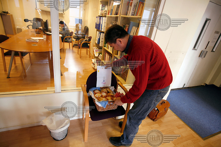 Media interest: Cheif Editor Aye Chan Naing offers buns made by his daughter to visiting journalists. Democratic Voice of Burma is radio and TV station run by exiled Burmese. Opposing the government, the DVB has been transmitting, from the Norwegian capitol Oslo, into Burma since 1992.