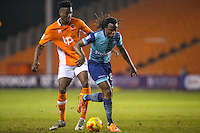 Marcus Bean of Wycombe Wanderers & Armand Gnanduillet of Blackpool during the The Checkatrade Trophy match between Blackpool and Wycombe Wanderers at Bloomfield Road, Blackpool, England on 10 January 2017. Photo by Andy Rowland / PRiME Media Images.