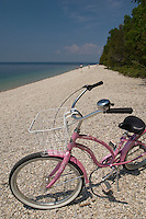 A pink bike on a Lake Huron beach at Mackinac Island in Michigan.