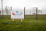 Satellite receiver dishes and sign for GCHQ facility near Bude, Cornwall