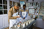 Factory Manager, Sanjay Mukherjee (right) looks on as Rajah Banerjee, the owner of Makaibari Tea Estates is seen tasting different types of teas like First Flush, Bai-mu-Dan, Silver Tips Imperial, Oolong and Second Flush Muscatel during a tea tasting at the office of Makaibari Tea Estate, Kurseong in Darjeeling, India.