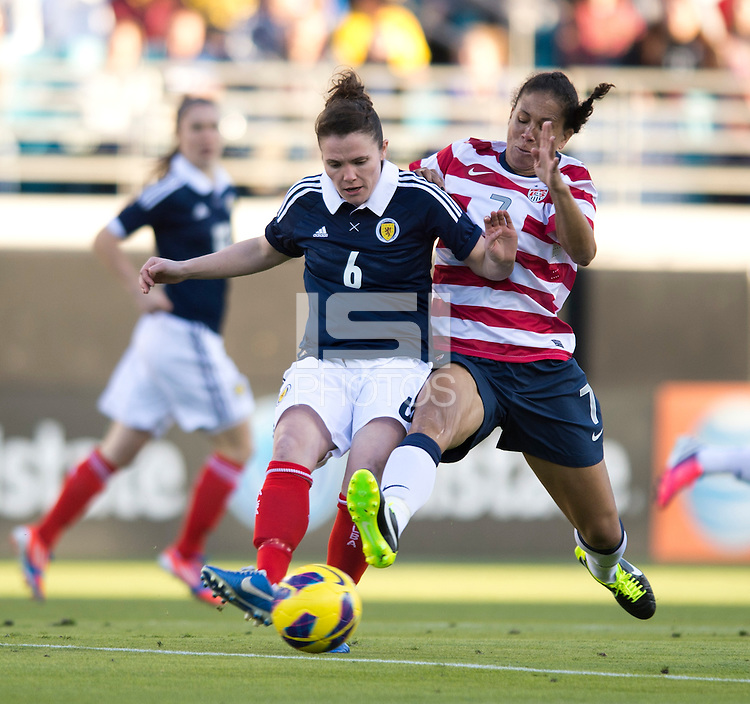 Shannon Boxx (7) of the USWNT fights for the ball with Joanne Love (6) of Scotland during the game at EverBank Field in Jacksonville, Florida.  The USWNT defeated Scotland, 4-1.