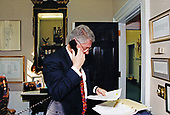 Upon reading a news account of American Olympic speed skater Dan Jansen's Gold Medal win in the 1,000 meter race, United States President Bill Clinton calls Jansen in Lillehammer, Norway from his study in the White House in Washington, DC on February 18, 1994 to offer his congratulations.<br /> Credit: White House via CNP