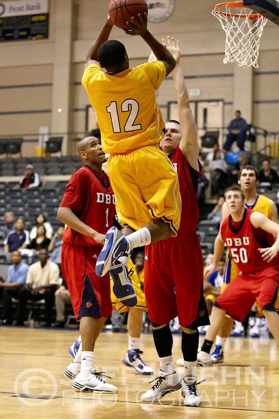 SAN ANTONIO , TX - JANUARY 23, 2010: The Dallas Baptist University Patriots vs. the St. Mary's University Rattlers Men's Basketball at the Bill Greehey Arena. (Photo by Jeff Huehn)