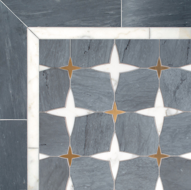 Michael, a waterjet stone mosaic, shown in honed Bardiglio, polished Calacatta Tia, and Brass, is part of the Trove™ collection for New Ravenna.Ravenna.