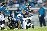 October 24, 2011:   Baltimore Ravens running back Ray Rice (27) is stopped by the Jaguars defense during second half action between the Jacksonville Jaguars and the Baltimore Ravens played at EverBank Field in Jacksonville, Florida.  Jacksonville defeated Baltimore 12-7.........