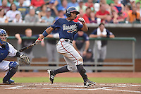 Mississippi Braves left fielder Cedric Hunter #17 swings at a pitch during a game against the Tennessee Smokies at Smokies Park on July 21, 2014 in Kodak, Tennessee. The Braves defeated the Smokies 4-3. (Tony Farlow/Four Seam Images)
