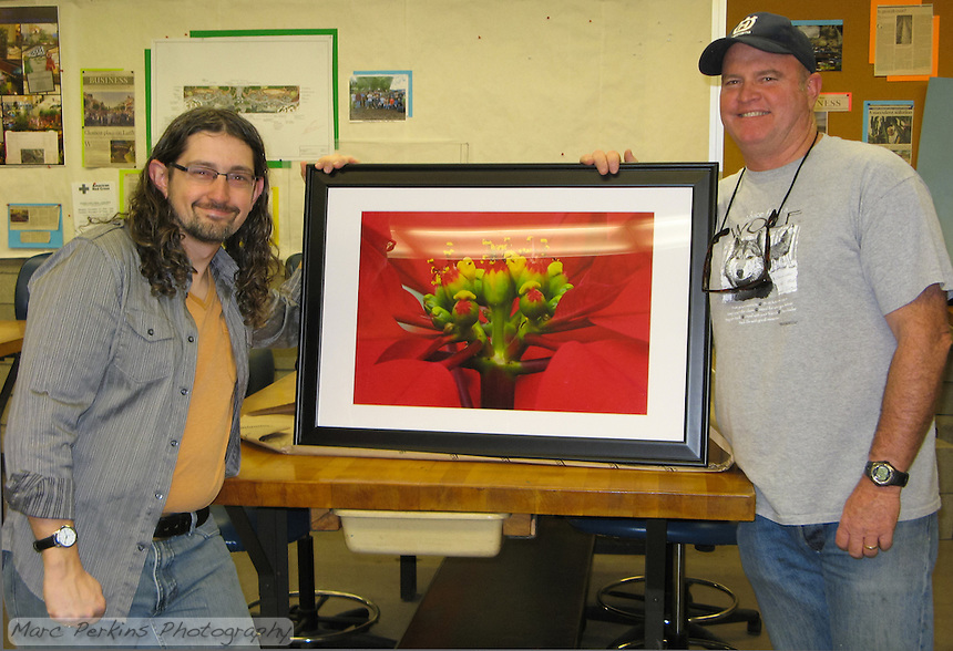 "Rick Harlow, lead faculty member of Orange Coast College's Ornamental Horticulture Department stands with me holding up a framed 16x24"" print of one of my poinsettia closeup pictures.  I donated the framed print to the department."