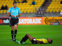 Referee Shaun Evans prepares to yellow card Roy Krishna during the A-League football match between Wellington Phoenix and Newcastle Jets at Westpac Stadium, Wellington, New Zealand on Sunday, 11 October 2015. Photo: Dave Lintott / lintottphoto.co.nz
