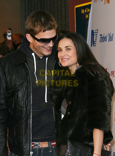 ASHTON KUTCHER & DEMI MOORE.Rebel Yell Spring Launch Party - Arrivals held at Kitson, .Beverly Hills, California, USA, .19 February 2006..half length celebrity couple married husband wife sunglasses leather jacket fur coat.Ref: ADM/ZL.www.capitalpictures.com.sales@capitalpictures.com.©Zach Lipp/AdMedia/Capital Pictures