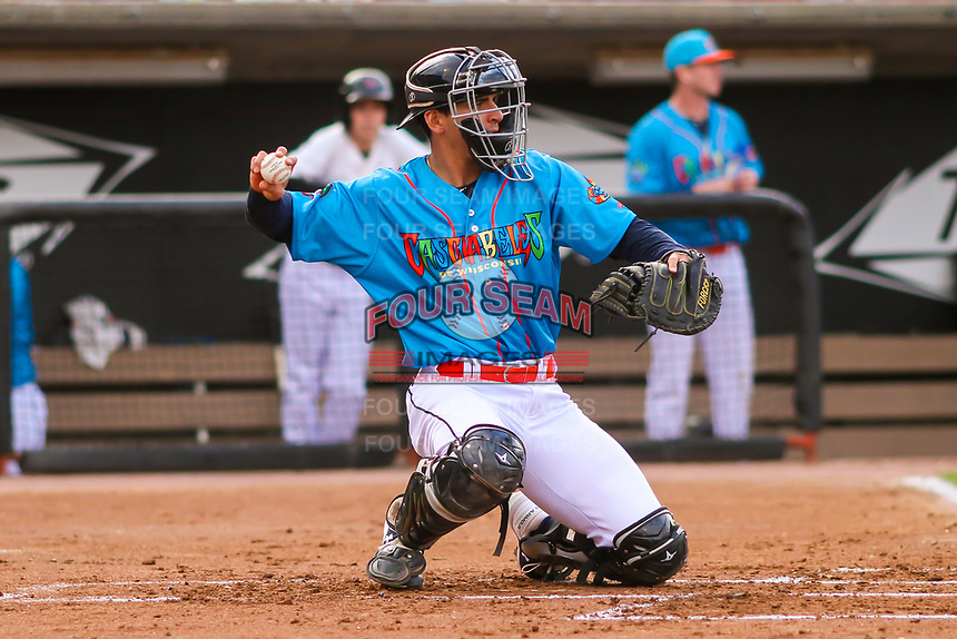 Wisconsin Timber Rattlers catcher Brent Diaz (18) warms up the pitcher between innings during a Midwest League game against the Lake County Captains on May 10, 2019 at Fox Cities Stadium in Appleton, Wisconsin. Wisconsin defeated Lake County 5-4. (Brad Krause/Four Seam Images)