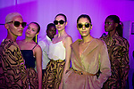 JOHANNESBURG, SOUTH AFRICA OCTOBER 29: Models walking for the Mozambican designer label Taibo Bacar wait backstage before a show at Mercedes Benz Africa fashion week Africa on October 29, 2014 held at Melrose Arch in Johannesburg, South Africa. Designers from all over Africa showed their best collections at the yearly event. (Photo by: Per-Anders Pettersson)