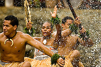 Men and women performe song and dance from the island of Fiji.
