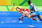 Sam Quek #13 of Great Britain passes the ball during India vs Great Britain in a Pool B game at the Rio 2016 Olympics at the Olympic Hockey Centre in Rio de Janeiro, Brazil.