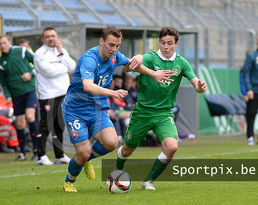 20150331 - MANNHEIM, Germany :<br /> <br /> Duel between Slovakian Juraj Chvatal (16) and Irish Joshua Cullen (14)<br /> , pictured during the soccer match between Under 19 teams of Republic of Ireland and Slovakia , on the third and last matchday  in Group 2 of the UEFA Elite Round Under 19 at the Carl-Benz Stadium, Mannheim, Germany<br /> <br /> Thursday 31 march 2015<br /> foto Dirk Vuylsteke / David CATRY