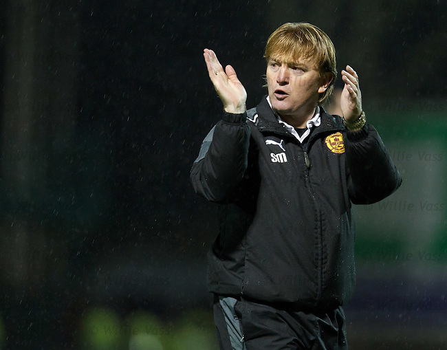 Motherwell manager Stuart McCall applauds the fans for turning out on such a miserable day