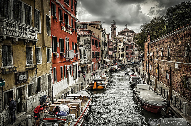 A view looking down Rio dei Tolentini in the sestiere of Santa Croce in Venice, Italy. The Papadopoli Gardens are behind the wall on the right.