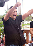 Robet Mizrachi celebrates hitting an Ace on the river to double up through Little.
