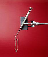 TEMPORARY MAGNET: FERROMAGNETISM<br /> Magnetized Nail Suspends Paper Clip.