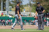 Modesto Nuts Manager Mitch Canham (6) has a discussion with the Base umpire Zach Neff at San Manuel Stadium on April 11, 2018 in San Bernardino, California.  The 66ers defeated the Nuts 7-0. (Donn Parris/Four Seam Images)